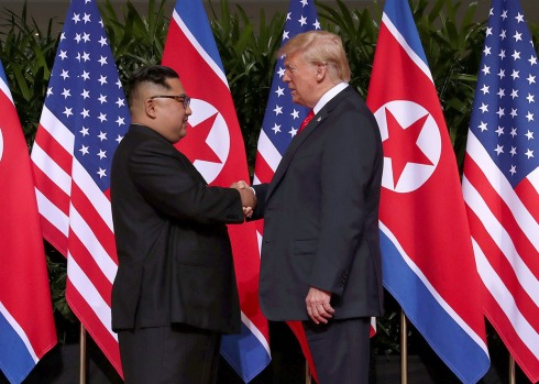 U.S. President Donald Trump shakes hands with North Korean leader Kim Jong Un at the Capella Hotel on Sentosa island in Singapore